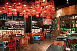 The Picture Shows the Interior Design with Full of Red Colored Lights Hanging on the ceiling.