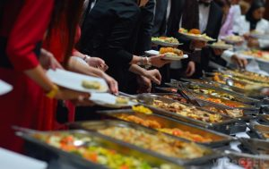 Guests in A Buffet Line of a Corporate Event organized by Event Management Service Kiyoh